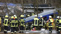 Rescue personnel at the scene in Germany after two trains crashed (AP)