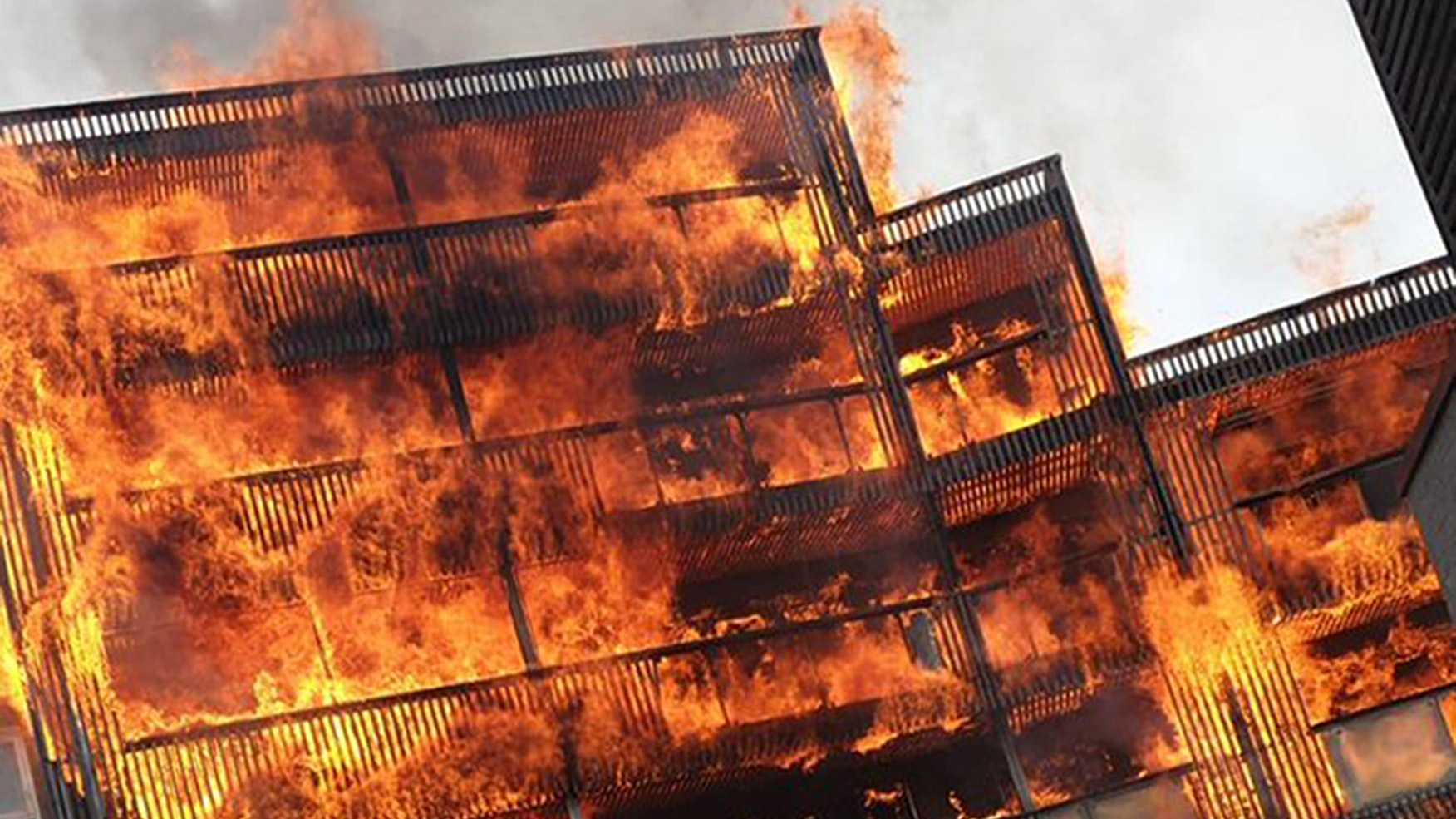A hundred firefighters battle vicious fire at block of flats in London