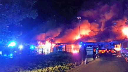 Firefighters tackle huge blaze in warehouse in Basildon, Essex