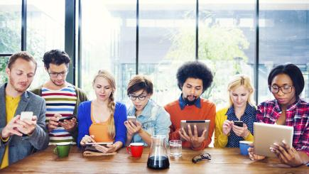 8 people sat at the table on mobile devices