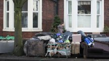 Furniture piled up outside a house as the clean-up continues following flooding in Carlisle, Cumbria