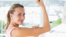 Stock image of woman flexing her bicep.