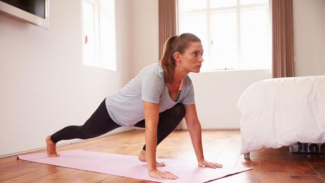Woman Exercising In Bedroom