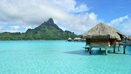 6 of the best luxury overwater bungalows to add to your travel wish list