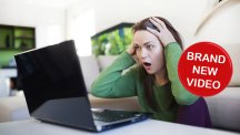 Woman looking unhappy with laptop T