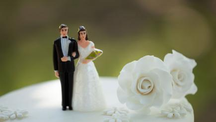 Stock image of figurines on top of wedding cake