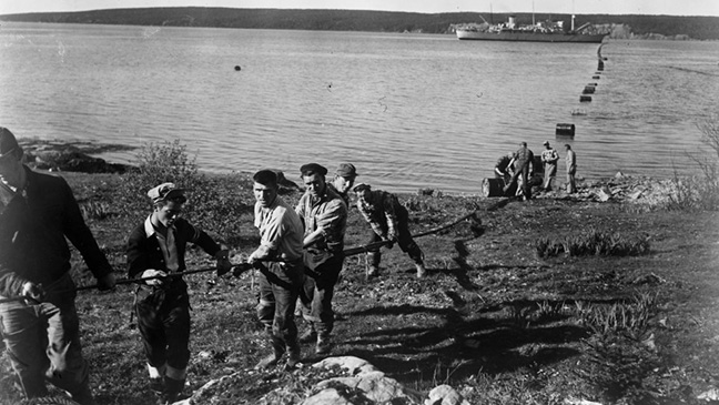 Cable operations at Clarenville, Newfoundland,  preparing to bring cable ashore, 1955. Image credit: Courtesy of BT Heritage & Archives