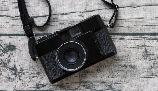 Camera with strap