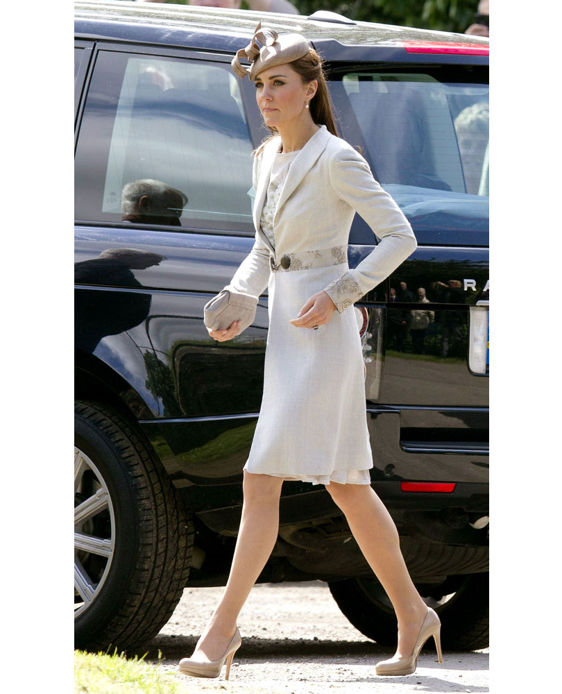 cf2f958857ea What Kate wore  A pale bluey grey dress coat over a hand-painted silk  floral Jenny Packham dress and taupe hat.