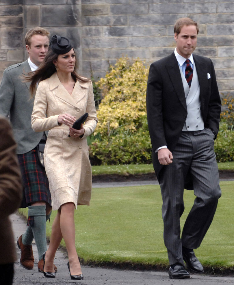 ce497fdd18c9 What Kate wore  A gold brocade coat (the same one worn to Zara and Mike  Tindall s wedding) black pillbox fascinator with black accessories.