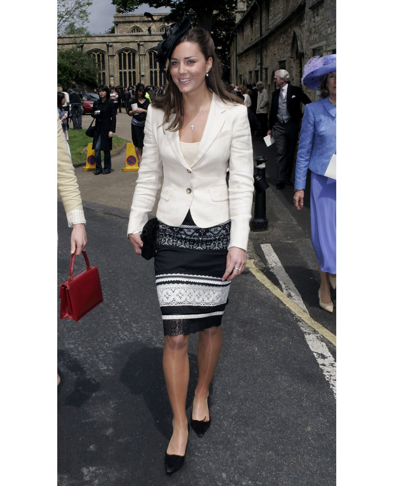 7cd2ffe93337 What Kate wore  A black and white lacy skirt with a white blazer and black  hat.