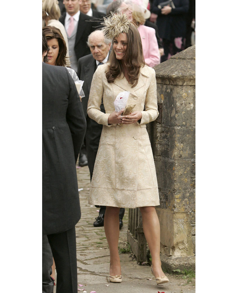 b433e1f308eb What Kate wore  That gold brocade coat (again) with a golden-plume covered  fascinator and matching gold satin heels.