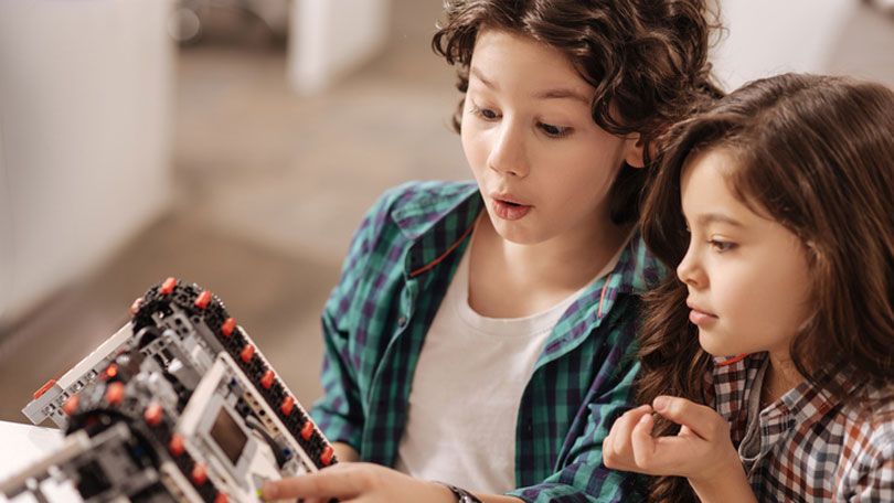 Children dealing with educational coding product