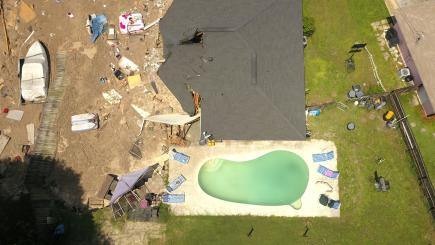 A sinkhole in Florida threatened to swallow up a neighbourhood