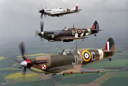 A Spitfire Mk VB in formation with a Spitfire Mk IXE (centre) and a Spitfire XIVE (top)