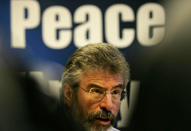 Sinn Fein president Gerry Adams speaks to the media in party headquarters, West Belfast, where he urged loyalist paramilitaries to follow the IRA and ditch their guns.