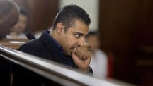 Journalist Mohammed Fahmy listens during his retrial in a courtroom in Tora prison in Cairo (AP)