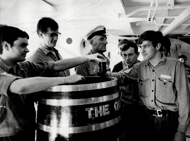 22-year-old Michael Gee receives one of the last rum rations to be served aboard HMS Albion.