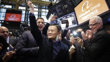 Jack Ma, centre, founder of Alibaba, raises a ceremonial mallet before striking a bell during the company's IPO at the New York Stock Exchange. (AP)