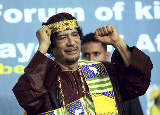 Gadhafi wears African tribal outfit as he greets attendences during the opening session of the second Conference Of the Forum of Kings, Sultans, Princes, Sheikhs and Mayors of Africa in Tripoli in 2010.