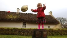Two-year-old Orla Stewart takes part in the Alloway 1759 Haggis Hurling Championships 2015 at Robert Burns Cottage. (PA)