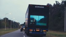 Samsung's new safety truck pictured from behind on a single-lane road.