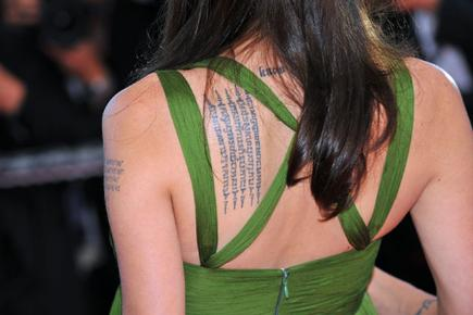 How to get that tattoo removed bt for Cheryl cole tattoo removal