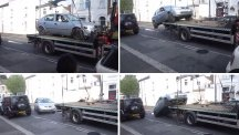 A driver takes his car off a lorry before it was taken away by parking contractors