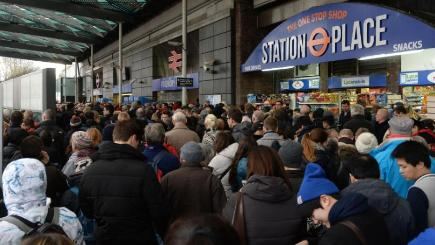 Travellers are locked out of Finsbury Park station, London, where they were directed to go as trains in and out of King's Cross were cancelled because of overrunning Network Rail engineering works