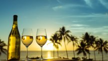 Wine glasses by the beach