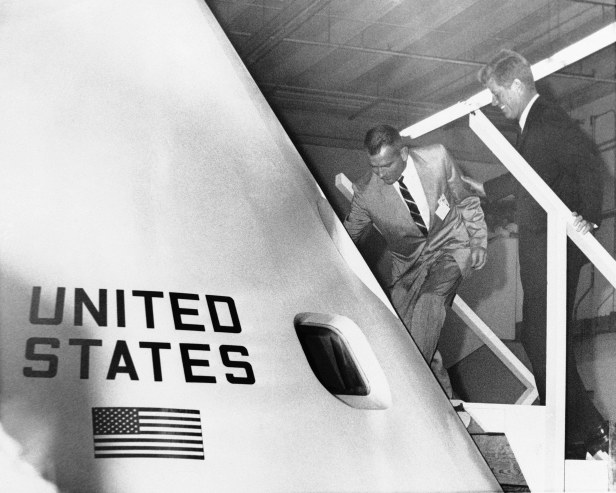 Astronaut Donald K. Slaton escorts President John F. Kennedy into a full-scale model of the project Apollo moon shot vehicle during his visit to the Nasa centre in Houston, Texas.