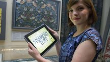 Sophia George with her iPad game inspired by the work of William Morris