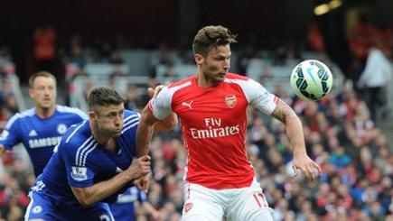 Gary Cahill and Olivier Giroud tussle for the ball in a 2014-15 season fixture.