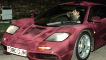 Comedian Rowan Atkinson at the wheel of his McLaren F1 GTR sports car which is expected to sell for £10m
