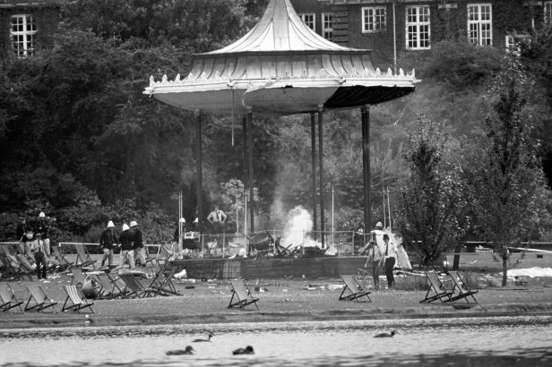 Police and firemen at the still-smouldering bandstand in Regents Park following the IRA bomb blast that killed six people and left many others seriously injured.