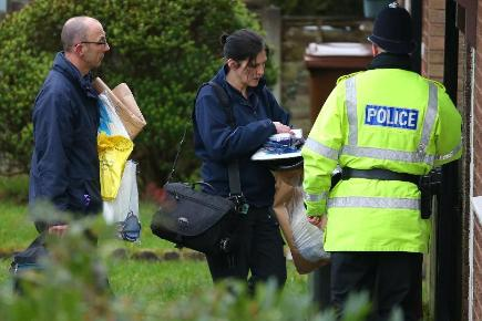 Police forensic officers arrive at a house on Emily Street in Blackburn, Lancashire, after an eleven month old baby girl died when she was mauled by a pet dog.