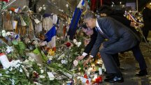 Barack Obama and Francois Hollande place flowers at the Bataclan (AP)