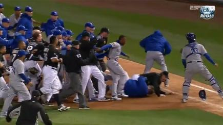 Screengrab of players from Chicago White Sox and Kansas City Royals taking part in a mass brawl.