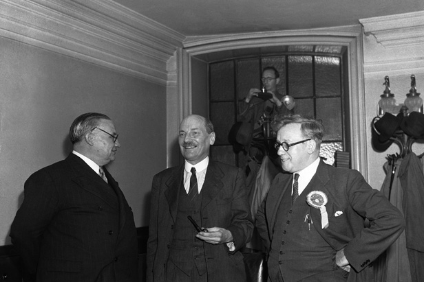 Ernest Bevin, Clement Attlee and Herbert Morrison at the Labour victory meeting at Central Hall, Westminster.