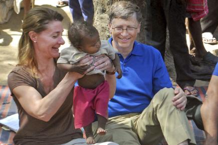 Bill Gates and his wife Melinda Gates meet a young local during a 2011 visit to Jamsot village near Patna, India.