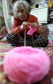 Blind grandmother knits thousands of jumpers, Shenyang, Liaoning Province, China