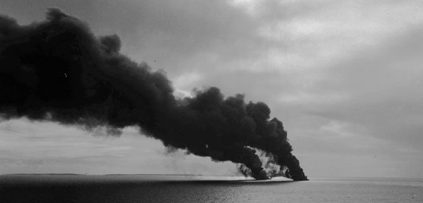 Smoke rises from the Torrey Canyon as bombers continue their task of blasting the 61,000-ton tanker