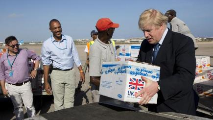 Foreign Secretary Boris Johnson helps to load food supplies on to a cargo plane at the airport in Mogadishu, Somalia (Karel Prinsloo/Unicef/AP)