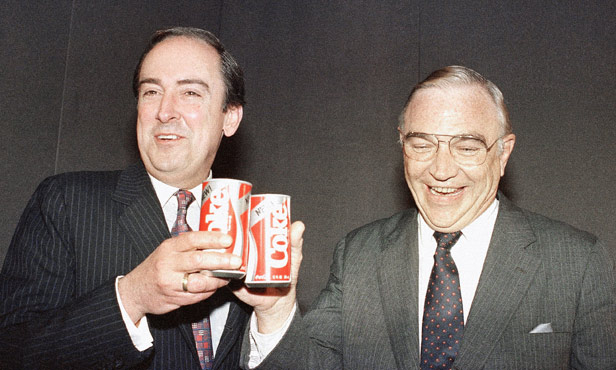 Robert C. Goizueta, Coca-Cola's chairman and CEO and Donald R. Keough, President and COO, toast the New Coke at its launch.