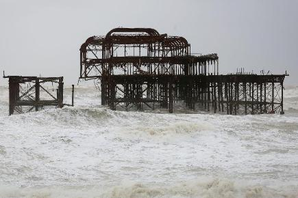The 148-year-old Grade-I listed West Pier in Brighton, East Sussex, has been further damaged by high winds and stormy seas