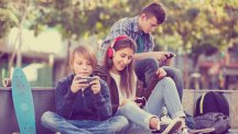 Three young people with phones