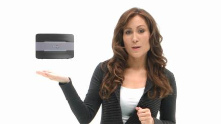 Woman with arm out holding Smart Hub