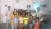 Members of BT's Indian team with girls at the orphanage and its founder Susheela Rayappa