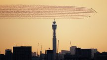 BT Tower at sunset with Red Arrow flypast