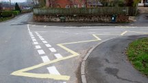 Bungling workmen paint yellow 'keep clear' zigzag lines in front of wrong building